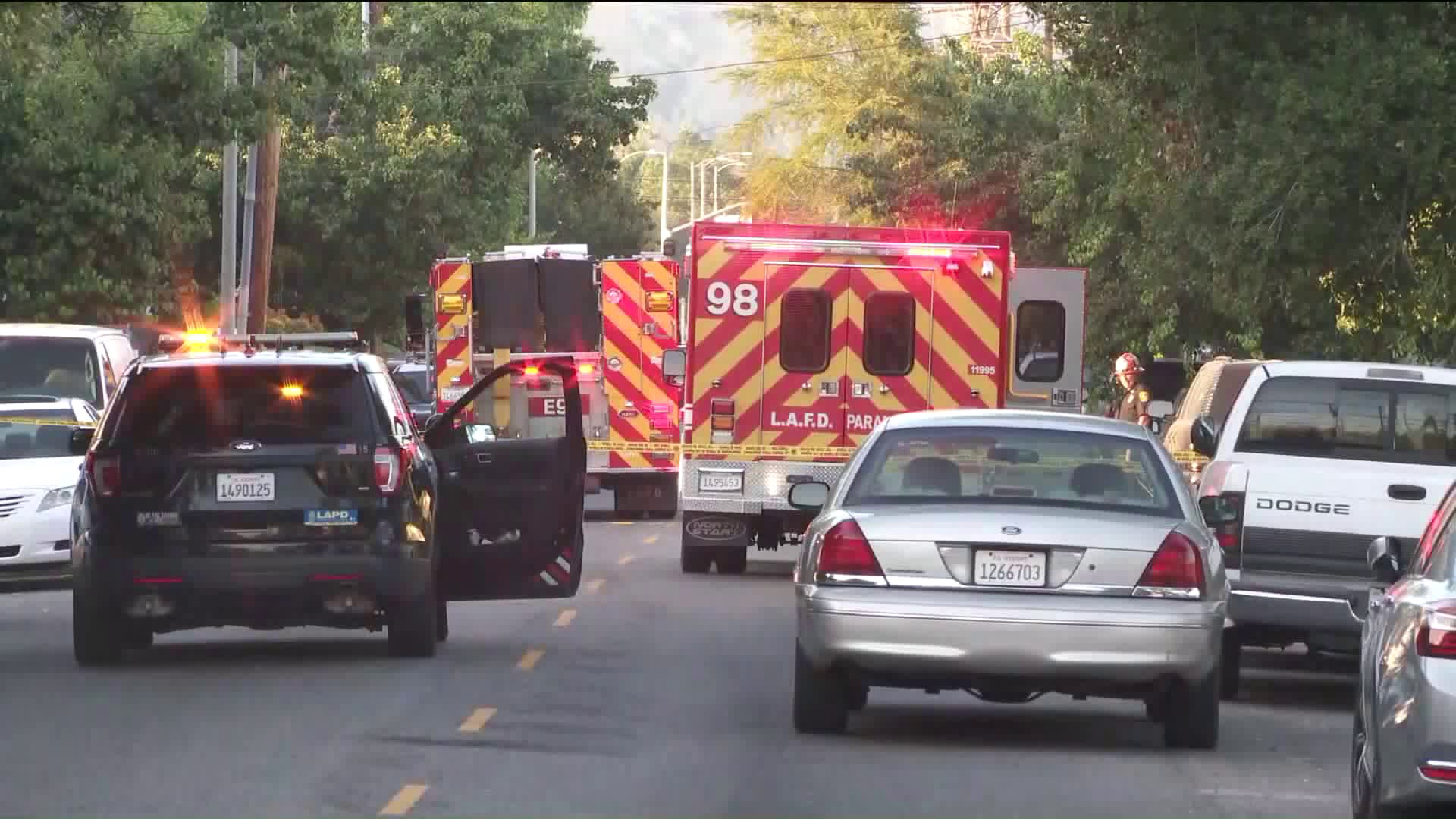 Police investigate the scene of a shooting that left two people wounded in Sylmar on June 7, 2019. (Credit: KTLA)