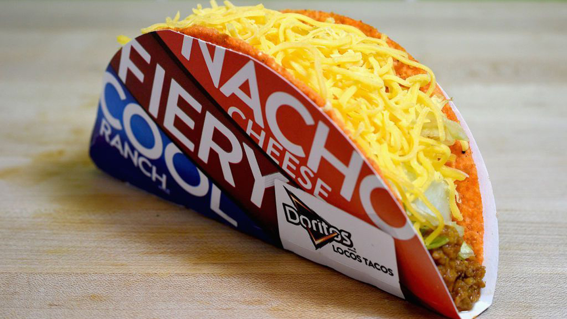 A promotional image of the Doritos Locos taco from Taco Bell.