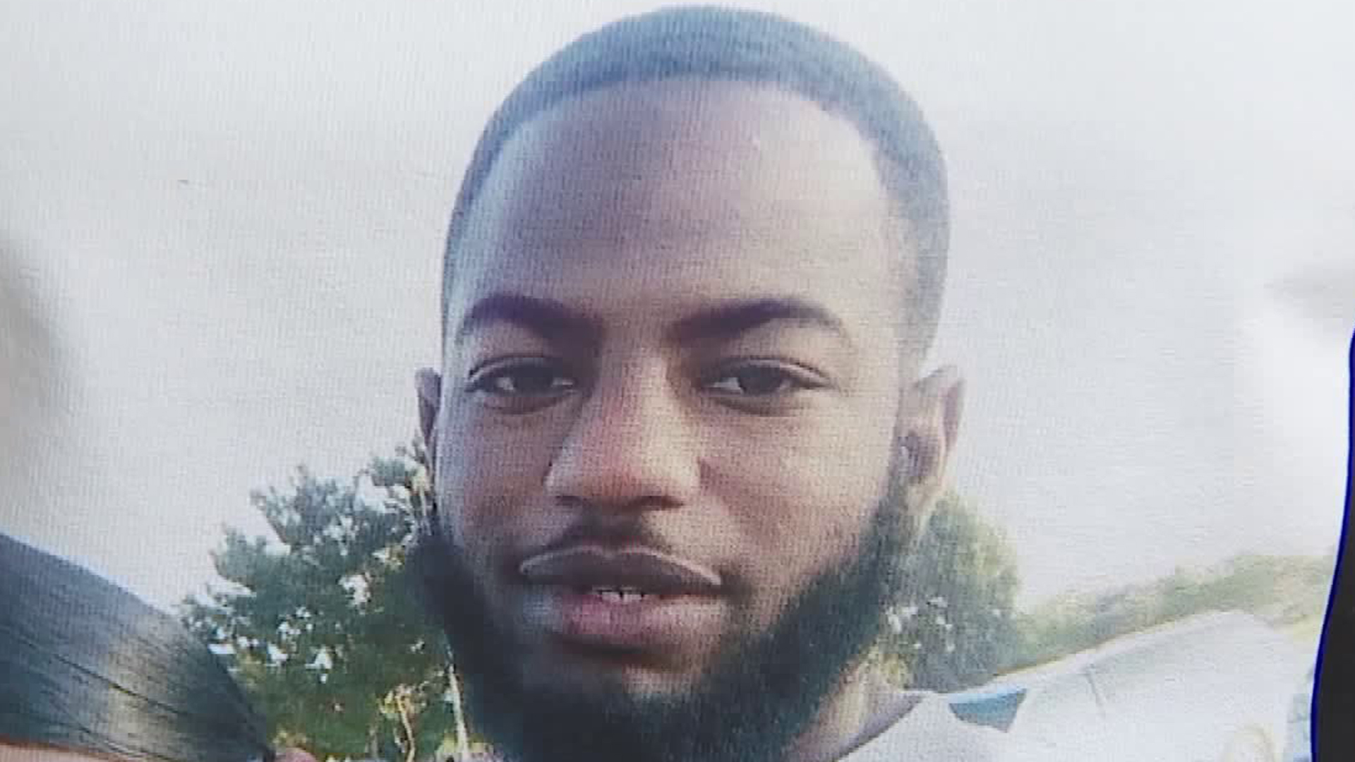 Ryan Twyman, 24, is seen in a photo shown on a T-shirt worn by a person attending a fundraiser for his family in Willowbrook on June 14, 2019. He was fatally shot by sheriff's deputies in the same neighborhood on June 6, 2019. (Credit: KTLA)