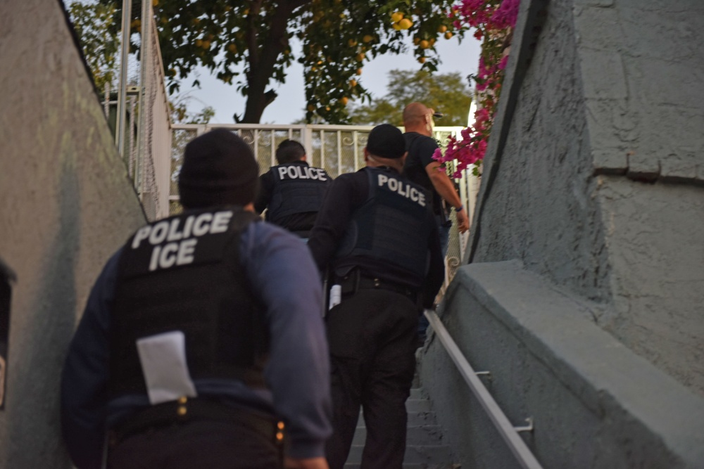Federal immigration agents execute a raid in the Los Angeles area on Feb. 16, 2019, in an image released by U.S. Immigration and Customs Enforcement.