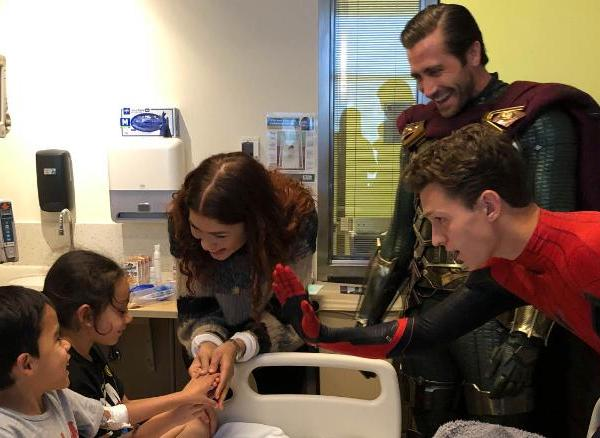 Zendaya and Jake Gyllenhaal and Tom Holland visit with patients at Children's Hospital Los Angeles in a photo provided by the hospital on July 1, 2019.