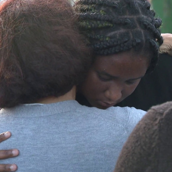Loved ones of Kaylanaa Davis, 7, gather outside a church in Port Hueneme on July 3, 2019, after she and her pregnant mother were shot and wounded the night before. (Credit: KTLA)