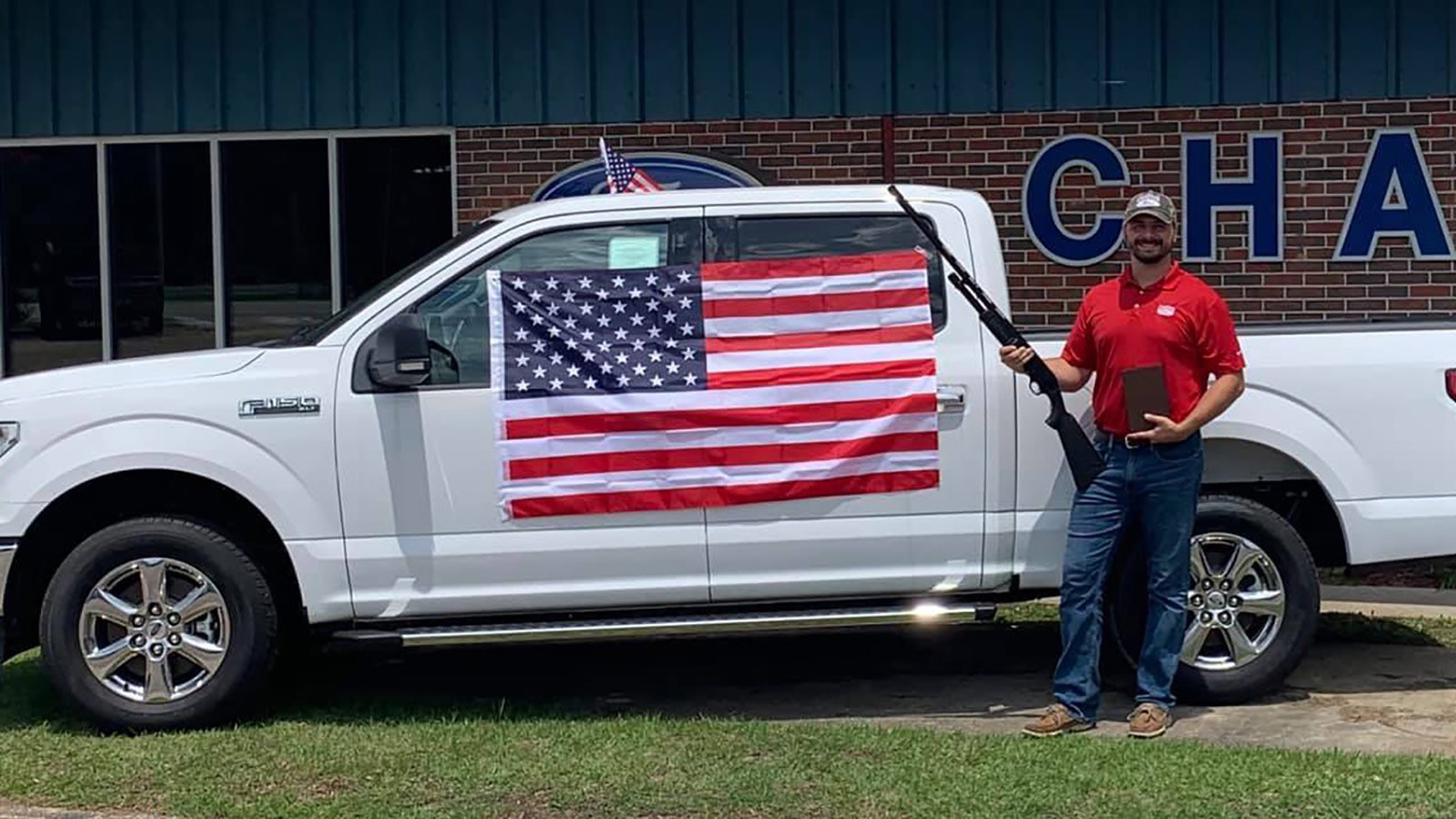 Chatom Ford in Alabama ended a promotion that gave away bibles, American flags and gift certificates for a shotgun to customers who purchased any new or used vehicle throughout July. (Credit: Chatom Ford via CNN)