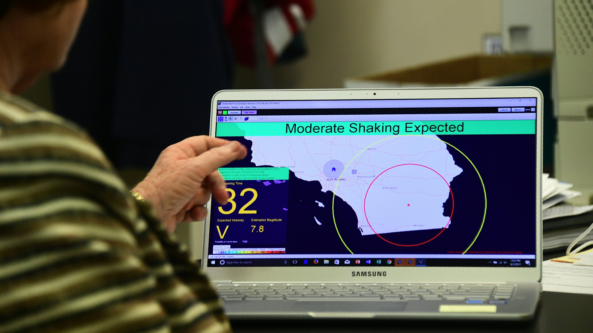 In this file photo, Margaret Vinci, manager of the Seismological Laboratory at Caltech points to a shake alert user display on a laptop screen, set for a limited release on June 1, 2017, at the Caltech Seismological Laboratory in Pasadena. (FREDERIC J. BROWN/AFP/Getty Images)
