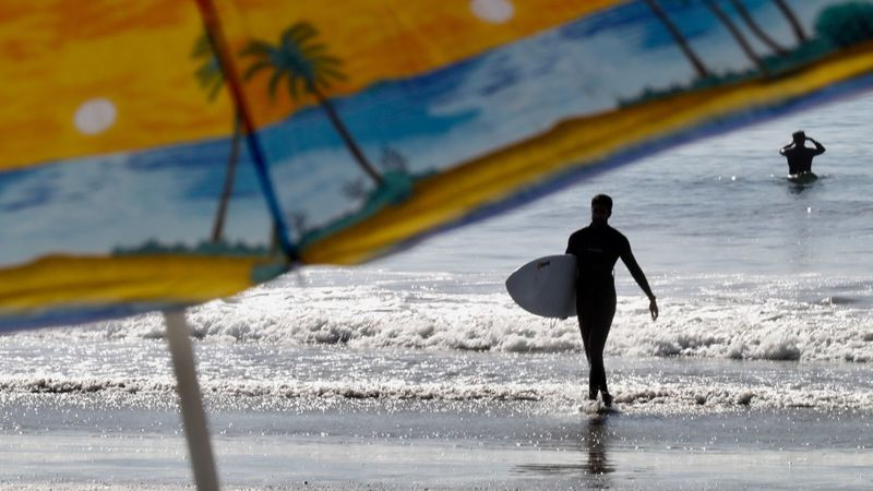 Surfers are seen in the ocean of a local beach in this undated filephoto. (Credit: (Genaro Molina/Los Angeles Times)