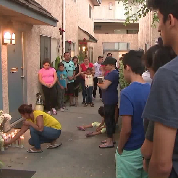 A memorial to the shooting victims at a Canoga Park apartment is seen on July 25, 2019. (Credit: KTLA)