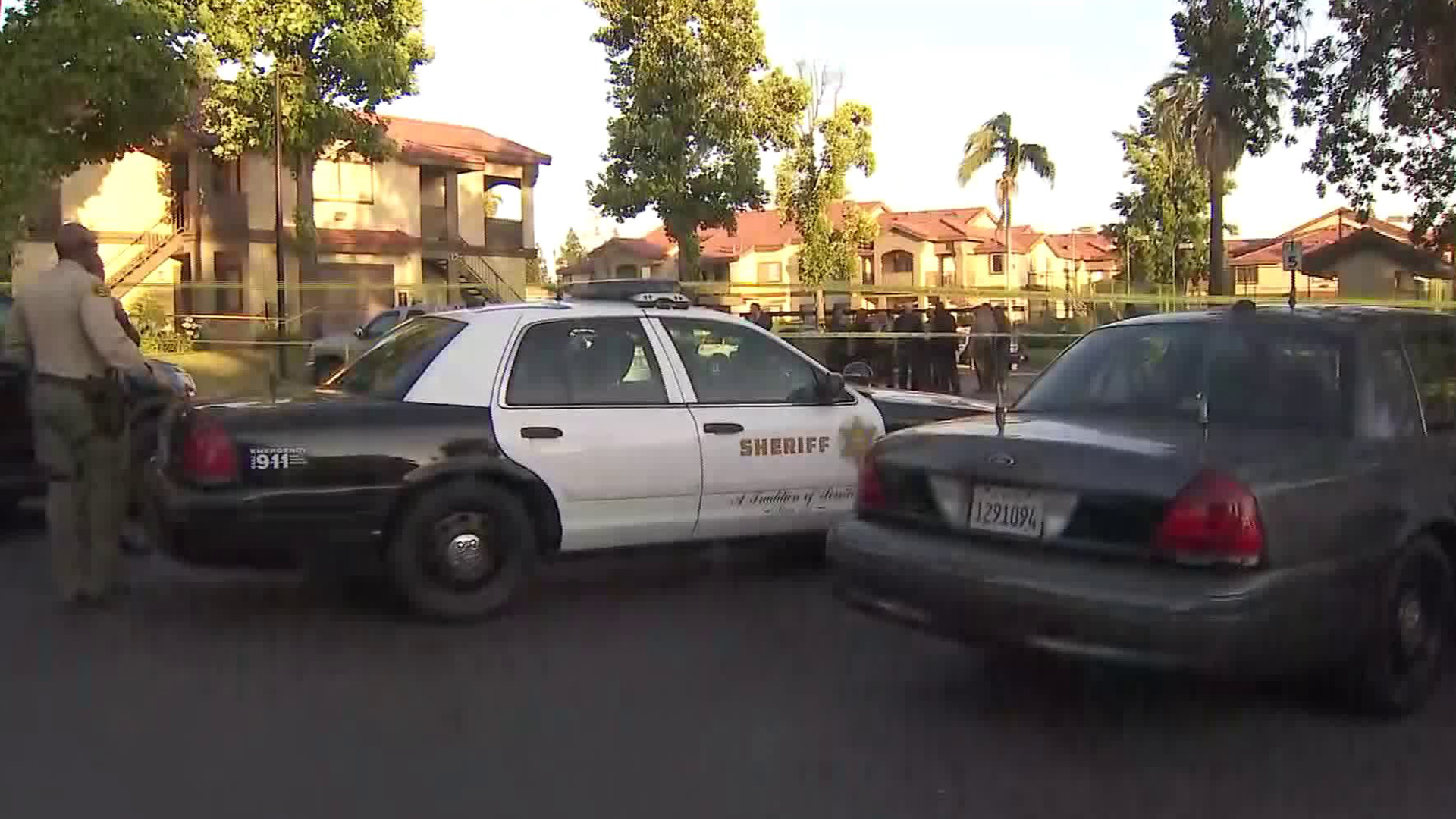 Officials investigate a shooting that left one man dead and another wounded at an apartment complex in the Covina area on July 17, 2019. (Credit: KTLA)