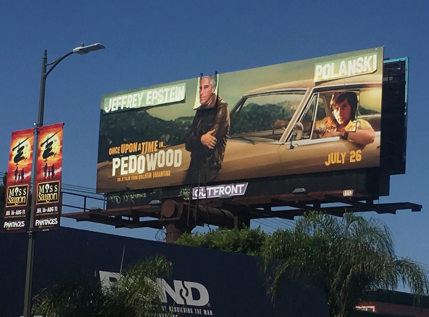 "A ""Once Upon a Time ... in Hollywood"" movie billboard on the south side of Pico at Alfred Street, one block east of La Cienega, is altered to show Jeffrey Epstein's and director Roman Polanski's face over actors Leonardo DiCaprio and Brad Pitt.(Credit: Jen Yamato / Los Angeles Times)"
