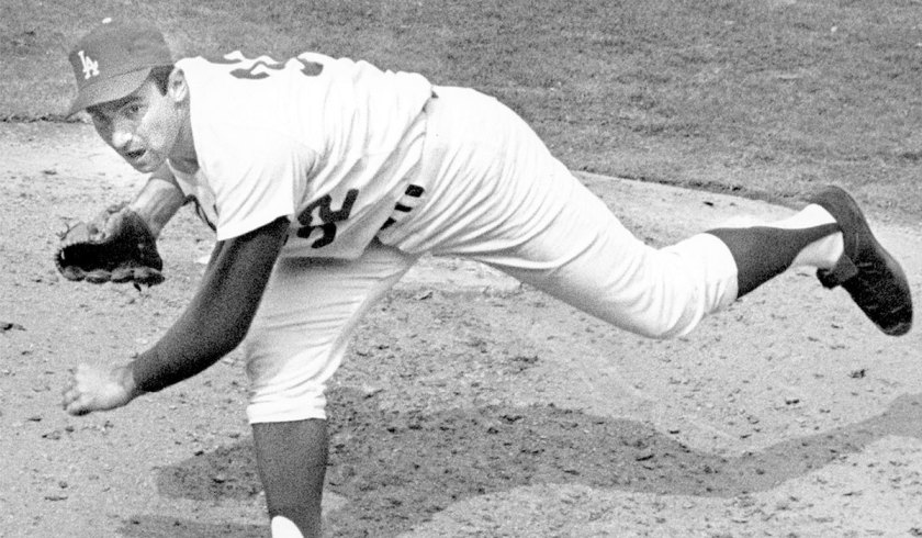 Sandy Koufax pitches in 1965, the year he started and won Game 7 of the World Series on two days' rest. (Credit: Ben Olender / Los Angeles Times)