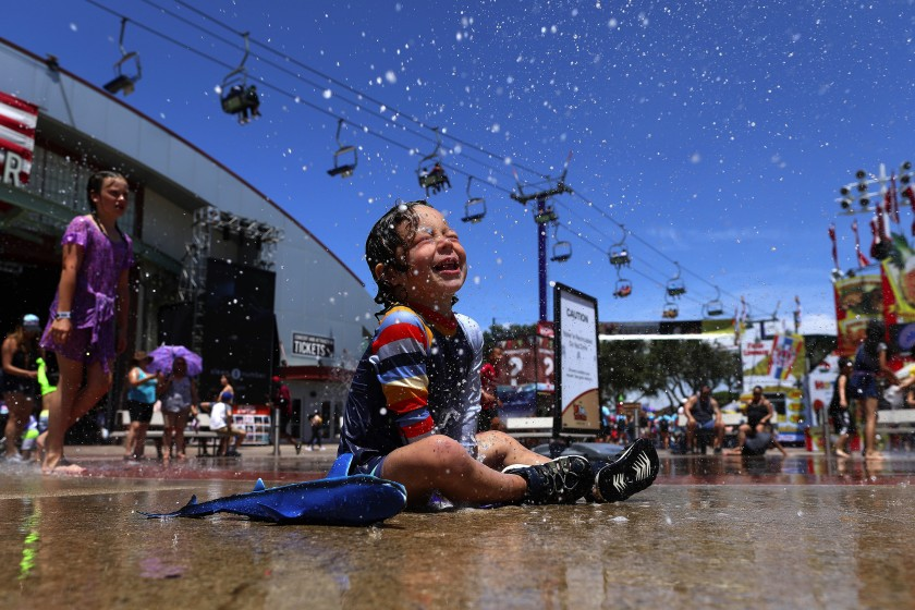 A 2-year-old tries to beat the heat at the Orange County Fair in Costa Mesa in this undated photo. (Credit: Gary Coronado / Los Angeles Times)