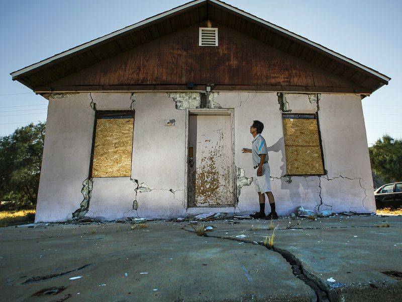 Jenner Kim of Trona examines his storage building, which was badly damaged by the Fourth of July quake in 2019. (Credit: Irfan Khan / Los Angeles Times)