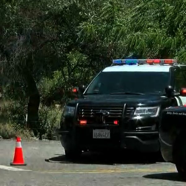 Authorities respond to the scene where a Fresno County sheriff's deputy was wounded near the mountain town of Tollhouse on July 2, 2019. (Credit: KGPE/KSEE via CNN)