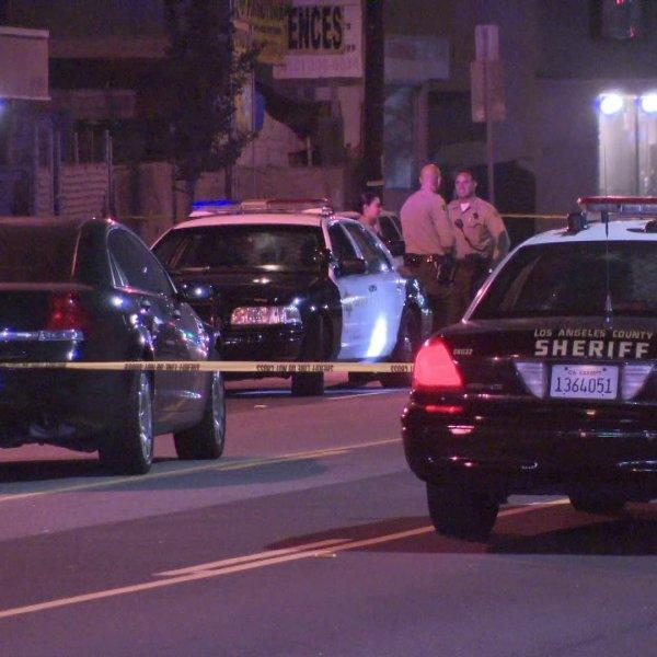 Sheriff's deputies work at the scene of fatal shooting in the 15300 block of Crenshaw Boulevard in Gardena on July 28, 2019. (Credit: KTLA)