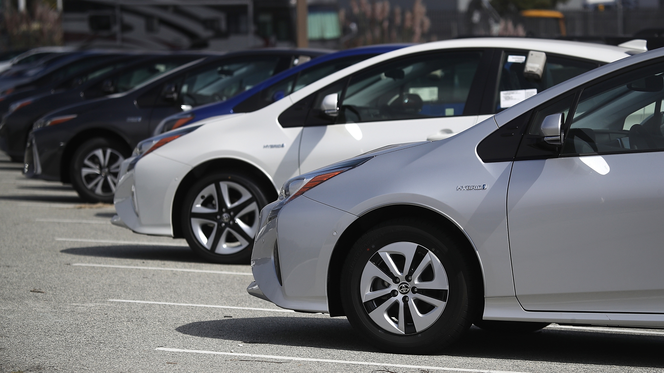 Brand new Toyota Prius cars are displayed on a sales lot at City Toyota on Sept. 5, 2018, in Daly City, Calif. (Credit: Justin Sullivan/Getty Images)