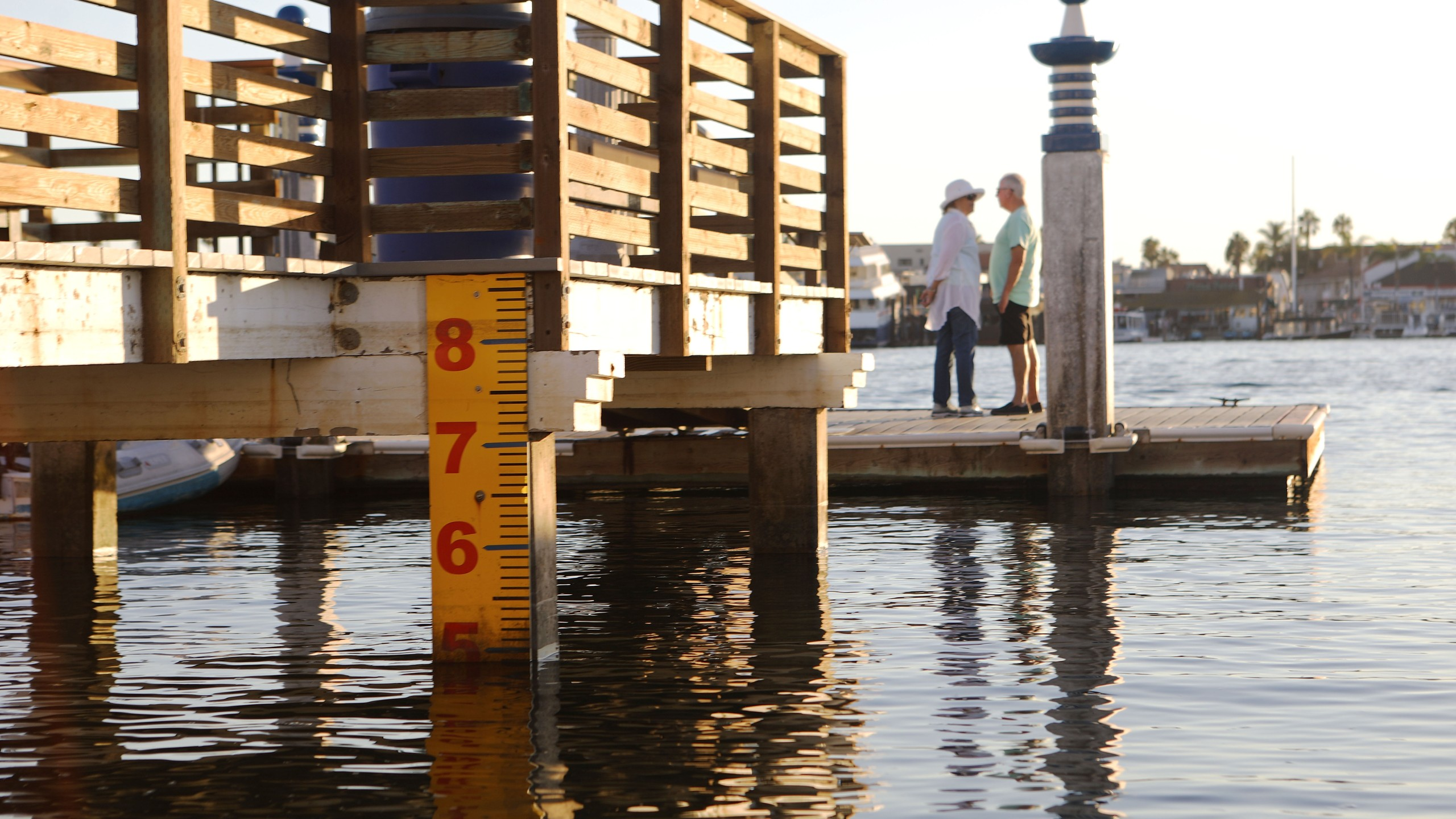 A water level marker is attached to a dock on Orange County's Balboa Island on Oct. 20, 2018, in Newport Beach, after officials raised the island's sea walls by nine inches. (Credit: Mario Tama/Getty Images)