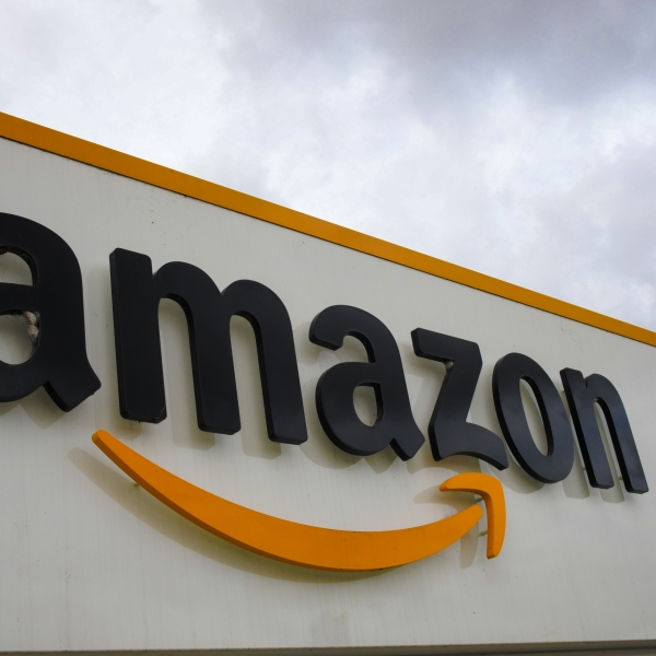 A picture shows the Amazon logo at the entrance area of the Amazon logistics centre in Lauwin-Planque, northern France, on March 4, 2019. (Credit: DENIS CHARLET / AFP/Getty Images)