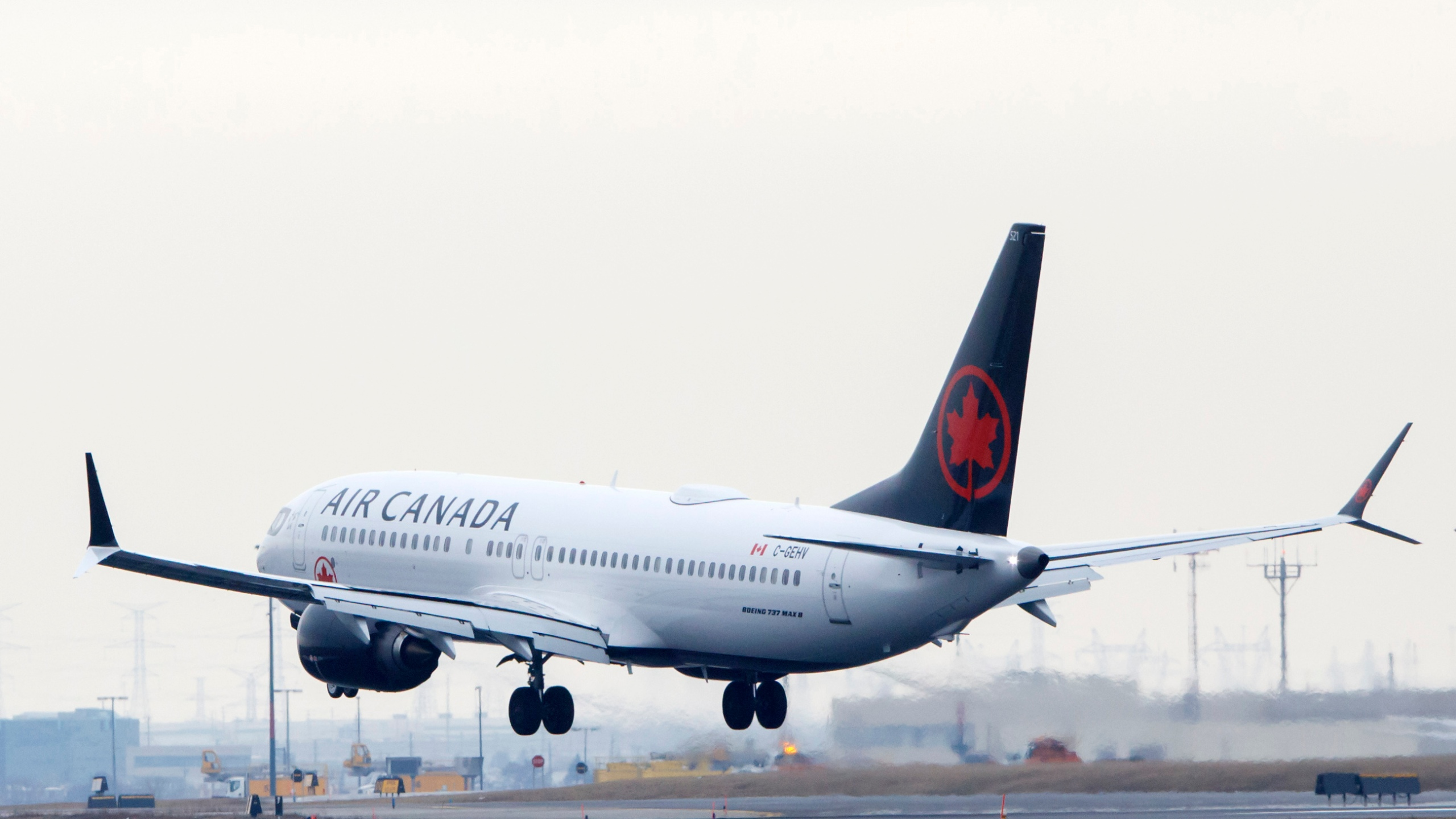 An Air Canada Boeing 737 MAX 8 jet approaches the Toronto Pearson International Airport for a landing on March 13, 2019, in Toronto, Canada. (Credit: Cole Burston/Getty Images)
