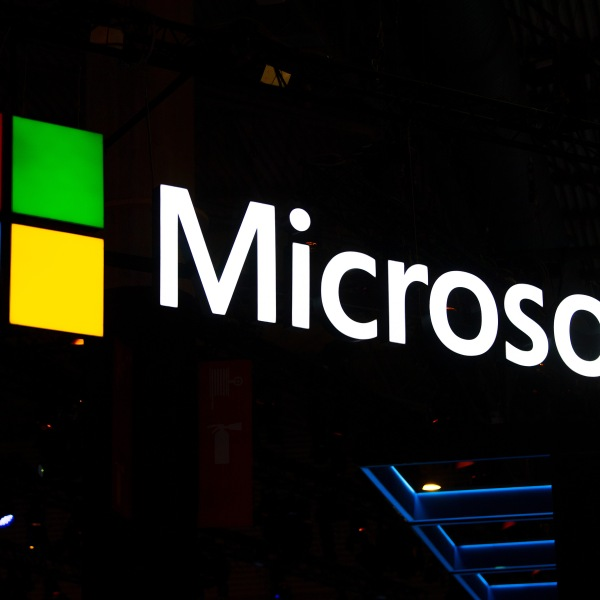 A Microsoft logo sits illuminated outside the company's booth at the GSMA Mobile World Congress in Barcelona, Spain, on Feb. 26, 2019. (Credit: David Ramos / Getty Images)
