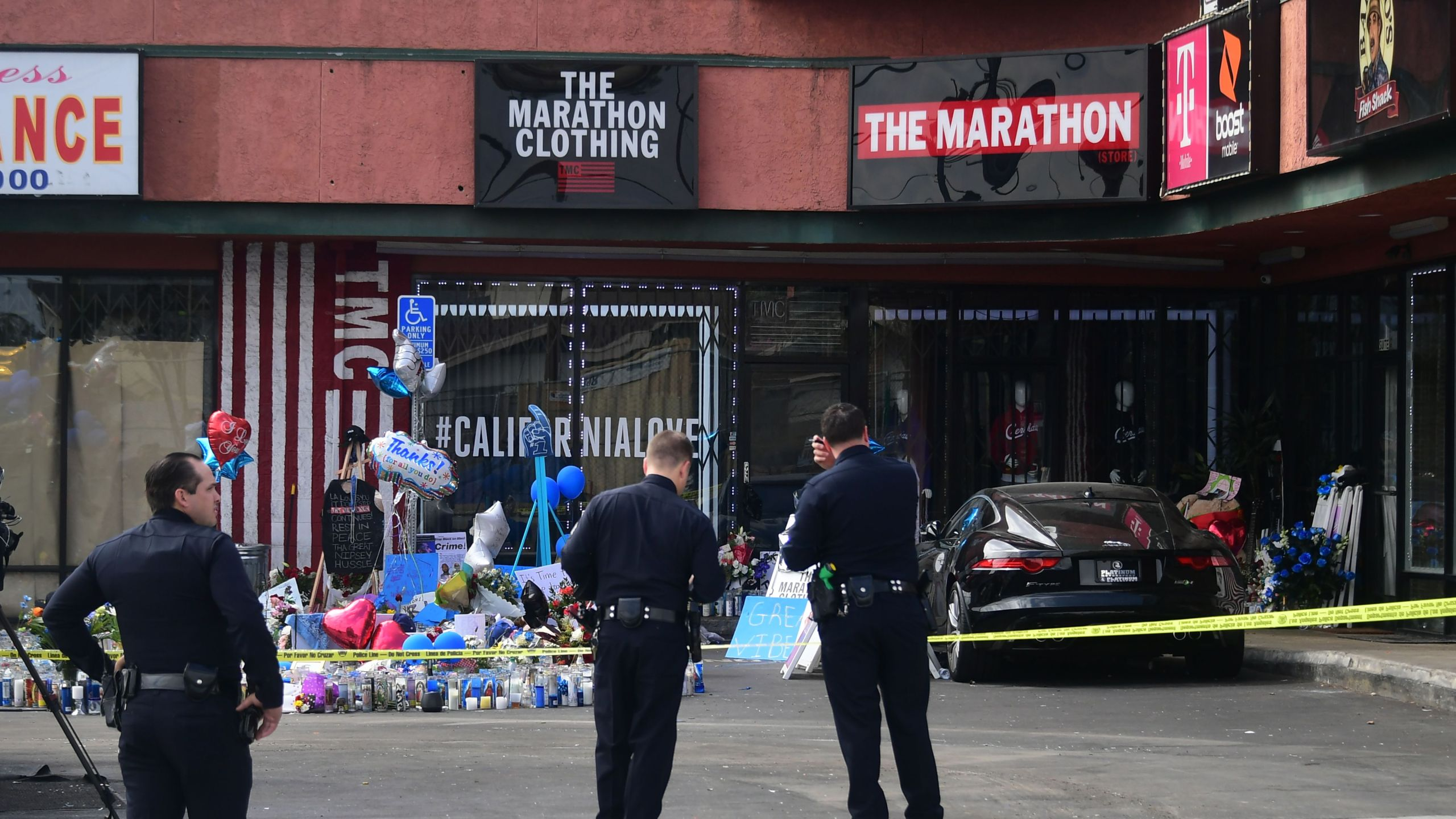 A makeshift memorial for Grammy-nominated rapper Nipsey Hussle sits in the parking lot in front of his Marathon Clothing store in Hyde Park on April 2, 2019. (Credit: Frederic J. Brown / AFP / Getty Images)