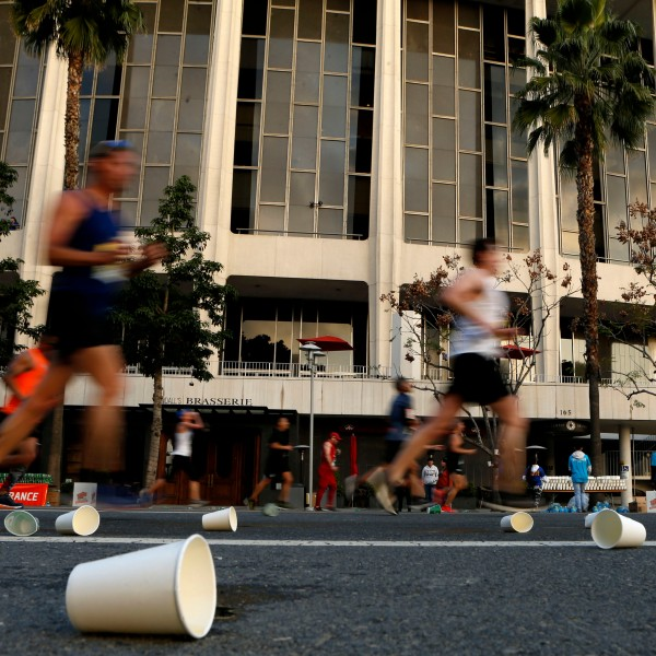 Competitors run past the Dorothy Chandler Pavilion during the 2019 Skechers Performance Los Angeles Marathon on March 24, 2019. (Credit: Katharine Lotze / Getty Images)