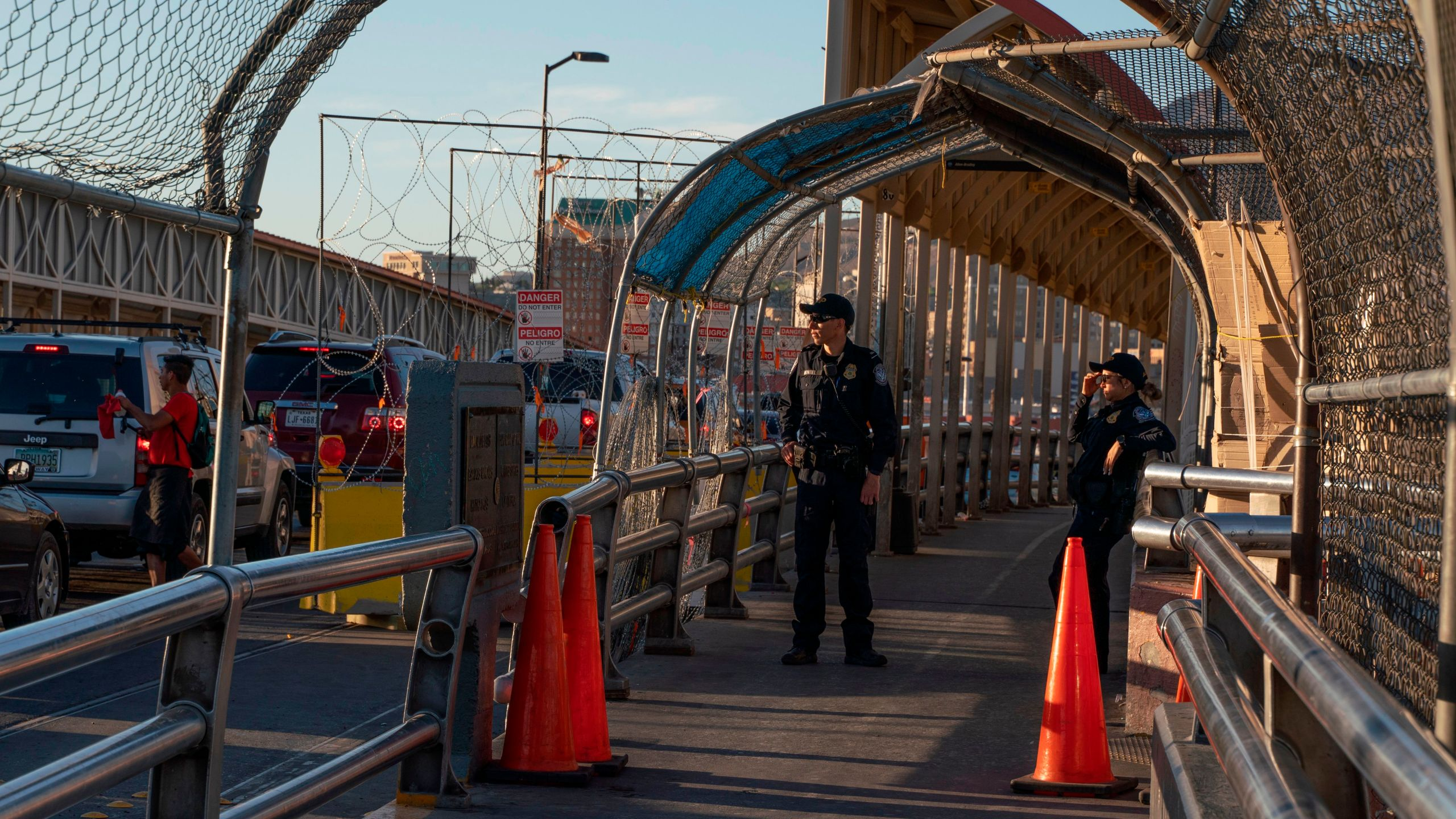 U.S. Customs and Border Protection officers are pictured at the border line where they check permits for crossing Paso Del Norte bridge between downtown El Paso and Ciudad Juarez, Mexico, on April 19, 2019. (Credit: PAUL RATJE/AFP/Getty Images)