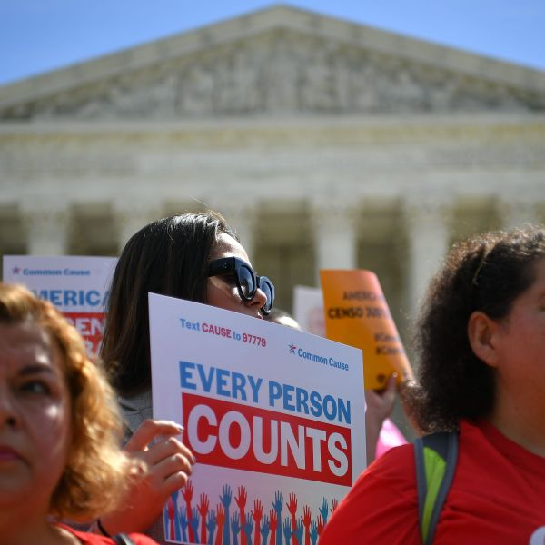 Demonstrators rally at the U.S. Supreme Court in Washington, DC, on April 23, 2019, to protest a proposal to add a citizenship question in the 2020 Census. (Credit: MANDEL NGAN/AFP/Getty Images)