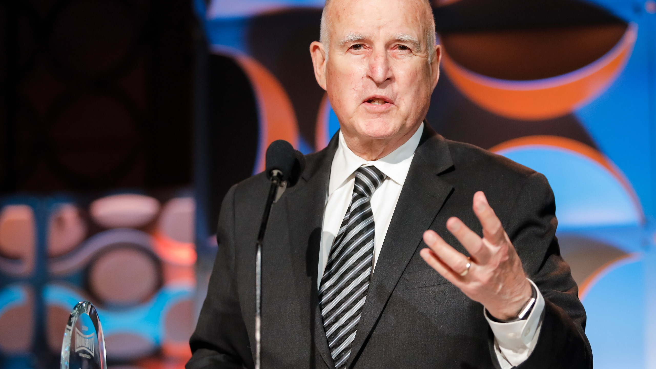 Former Gov. Jerry Brown receives an award from Homeboy Industries in Los Angeles on March 30, 2019. (Credit: Tibrina Hobson / Getty Images for Homeboy Industries)