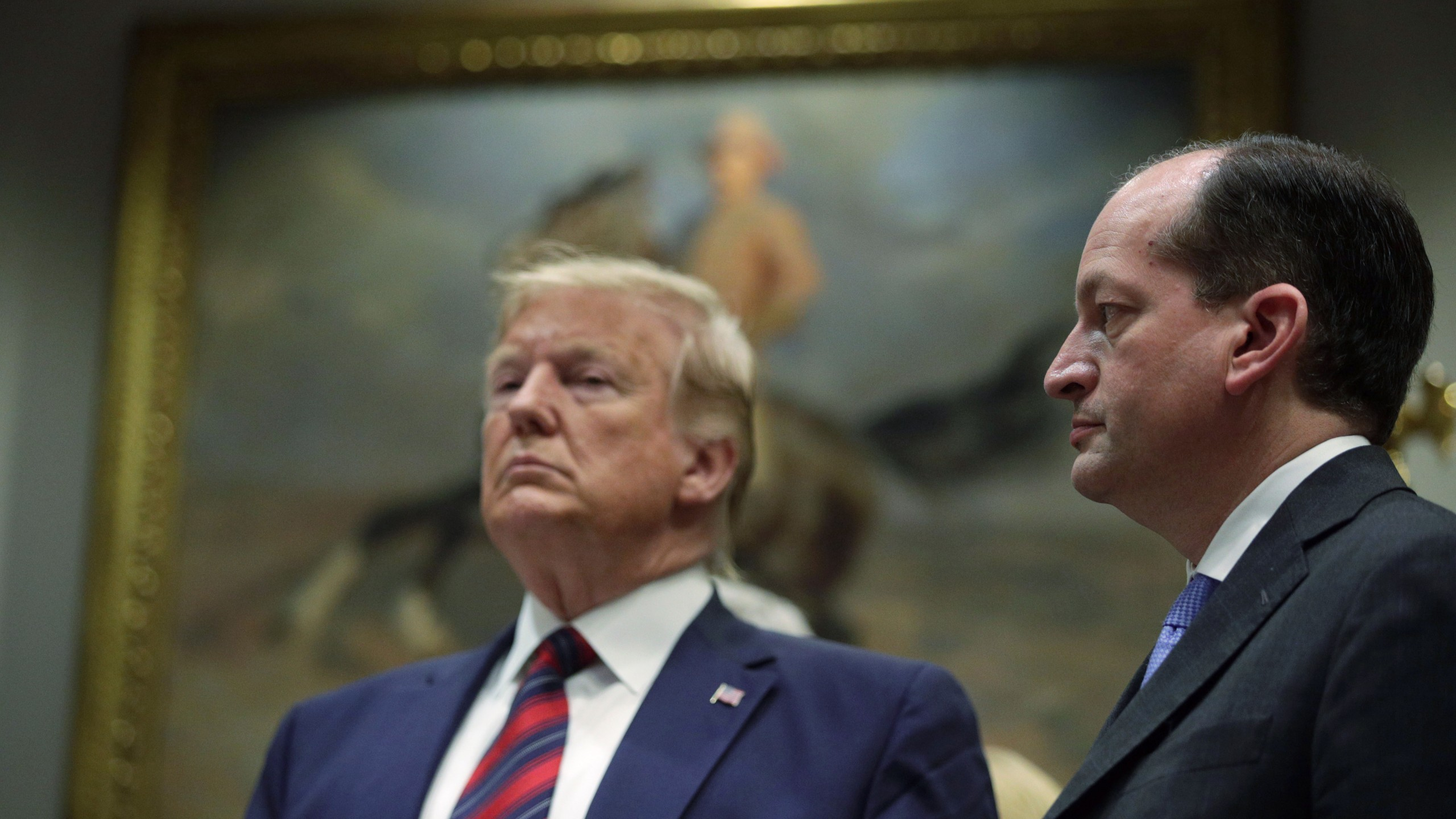 Donald Trump and Secretary of Labor Alexander Acosta listen during a Roosevelt Room event at the White House on May 9, 2019. (Credit: Alex Wong/Getty Images)