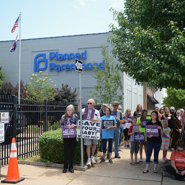 A group of anti-abortion demonstrators display signs during a rally outside the Planned Parenthood Reproductive Health Center in St Louis, Missouri, on June 4, 2019. (Credit: Michael B. Thomas / Getty Images)