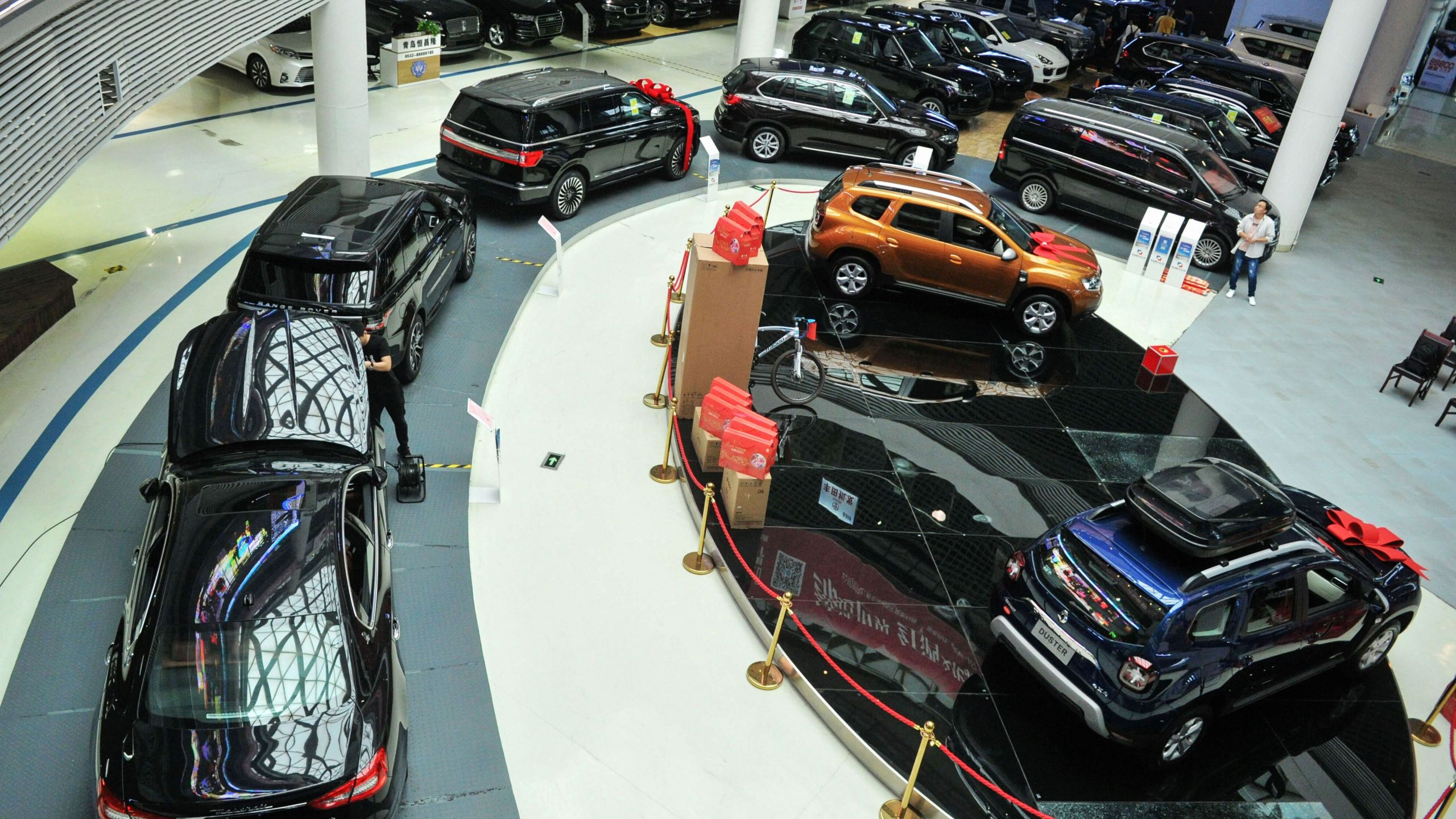 This photo taken on June 9, 2019, shows imported cars lined up in a showroom at the Qingdao, free trade port area in Qingdao, in China's eastern Shandong province.(Credit: STR/AFP/Getty Images)