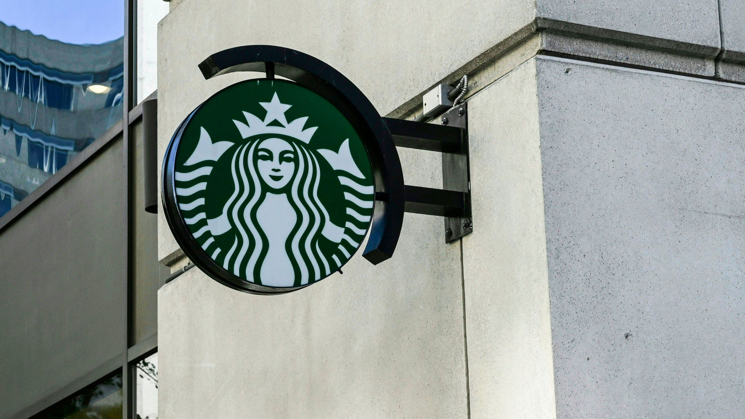 A Starbucks logo hangs over a store entrance in Washington, DC on June 11, 2019. (Credit: Eva Hambach/AFP/Getty Images)