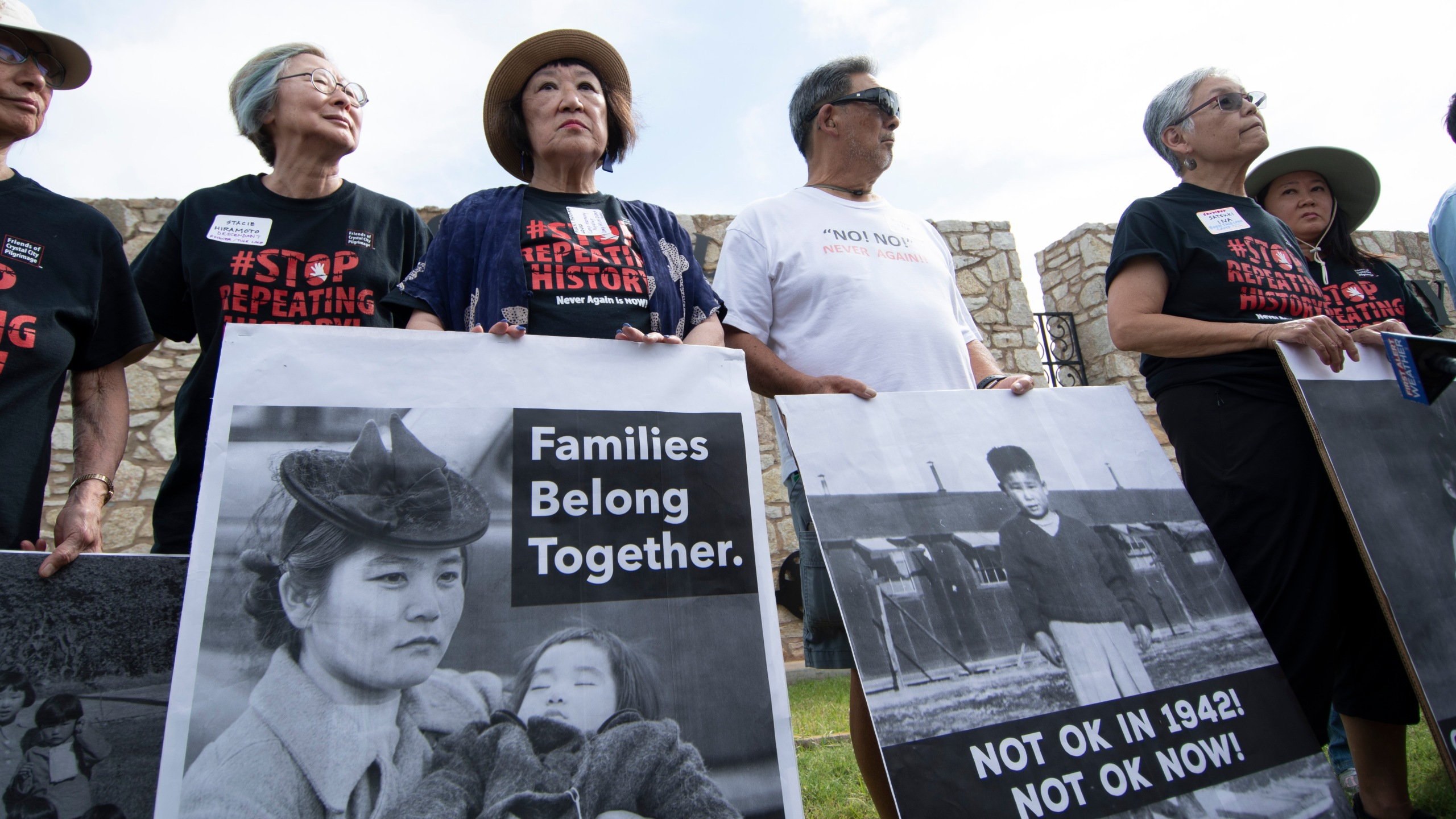 Japanese American protesters pose with photos of themselves taken while they were in relocation camps during World War II to rally against the detainment of migrant children at Fort Sill on June 22, 2019 in Lawton, Oklahoma. (Credit: J Pat Carter/Getty Images)