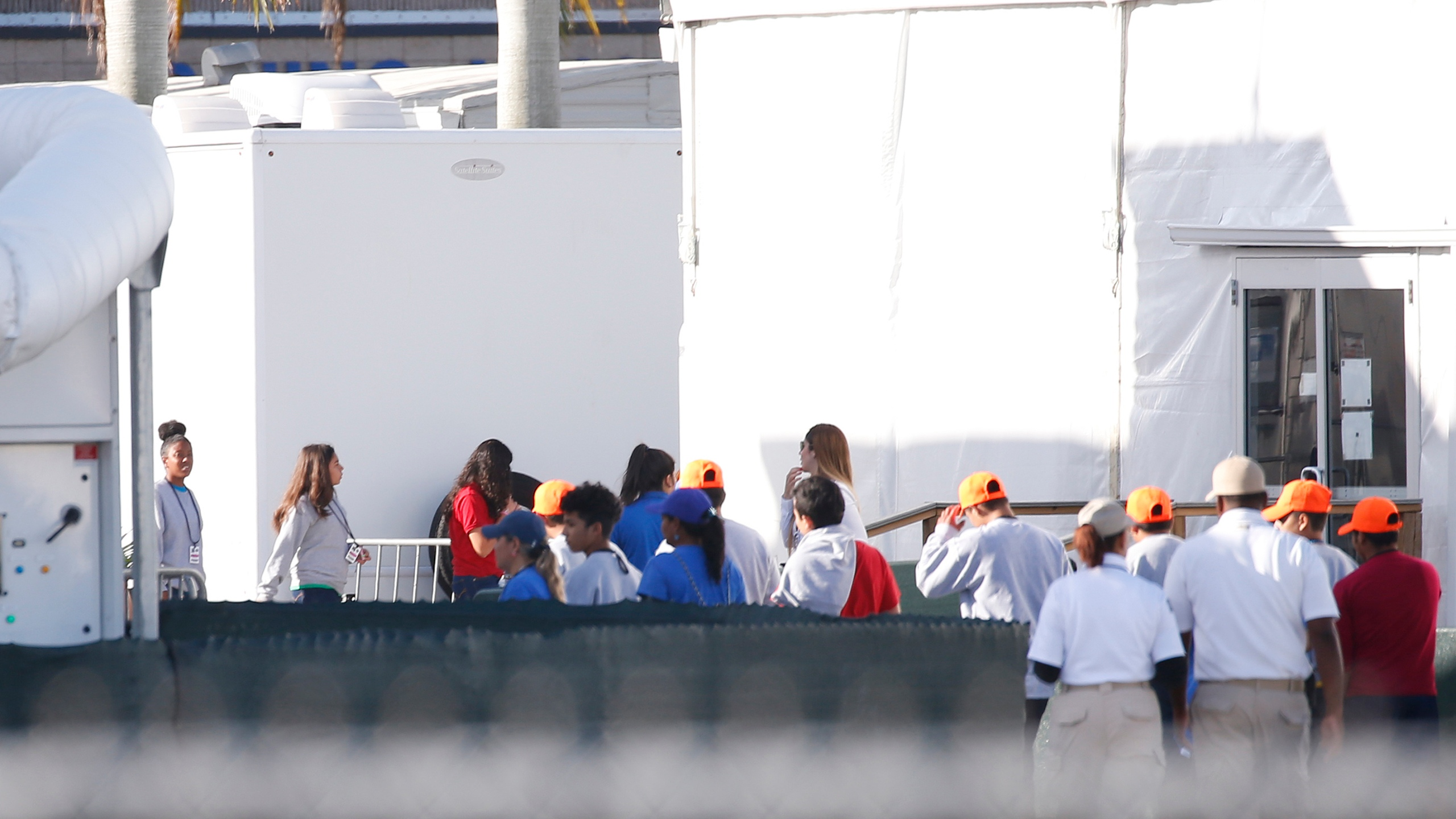 Migrant children who have been separated from their families can be seen in tents at a detention center in Homestead, Florida on June 28, 2019. (Credit: RHONA WISE/AFP/Getty Images)