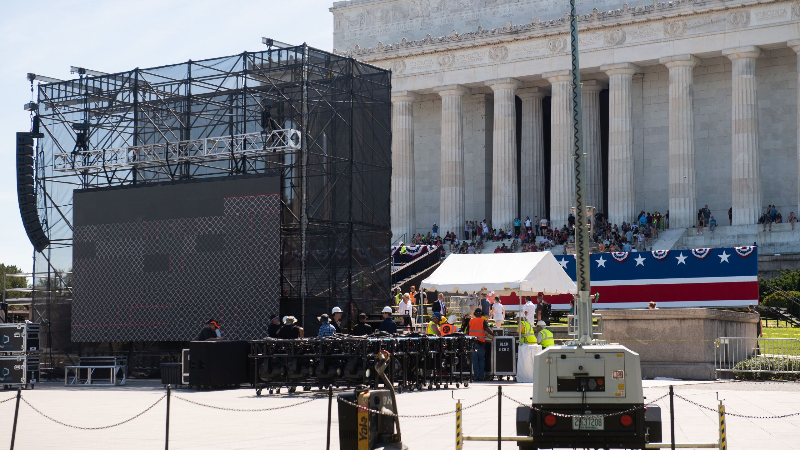 "Workers build a stage and bleachers for the ""Salute to America"" Fourth of July event with Donald Trump at the Lincoln Memorial on the National Mall in Washington, D.C., on July 1, 2019. (Credit: Saul Loeb/AFP/Getty Images)"