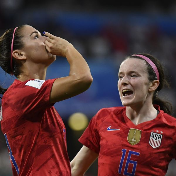 United States' forward Alex Morgan, left, celebrates after scoring a goal during the France 2019 Women's World Cup semi-final football match between England and USA, on July 2, 2019, at the Lyon Satdium in Decines-Charpieu, central-eastern France. (Credit: PHILIPPE DESMAZES/AFP/Getty Images)