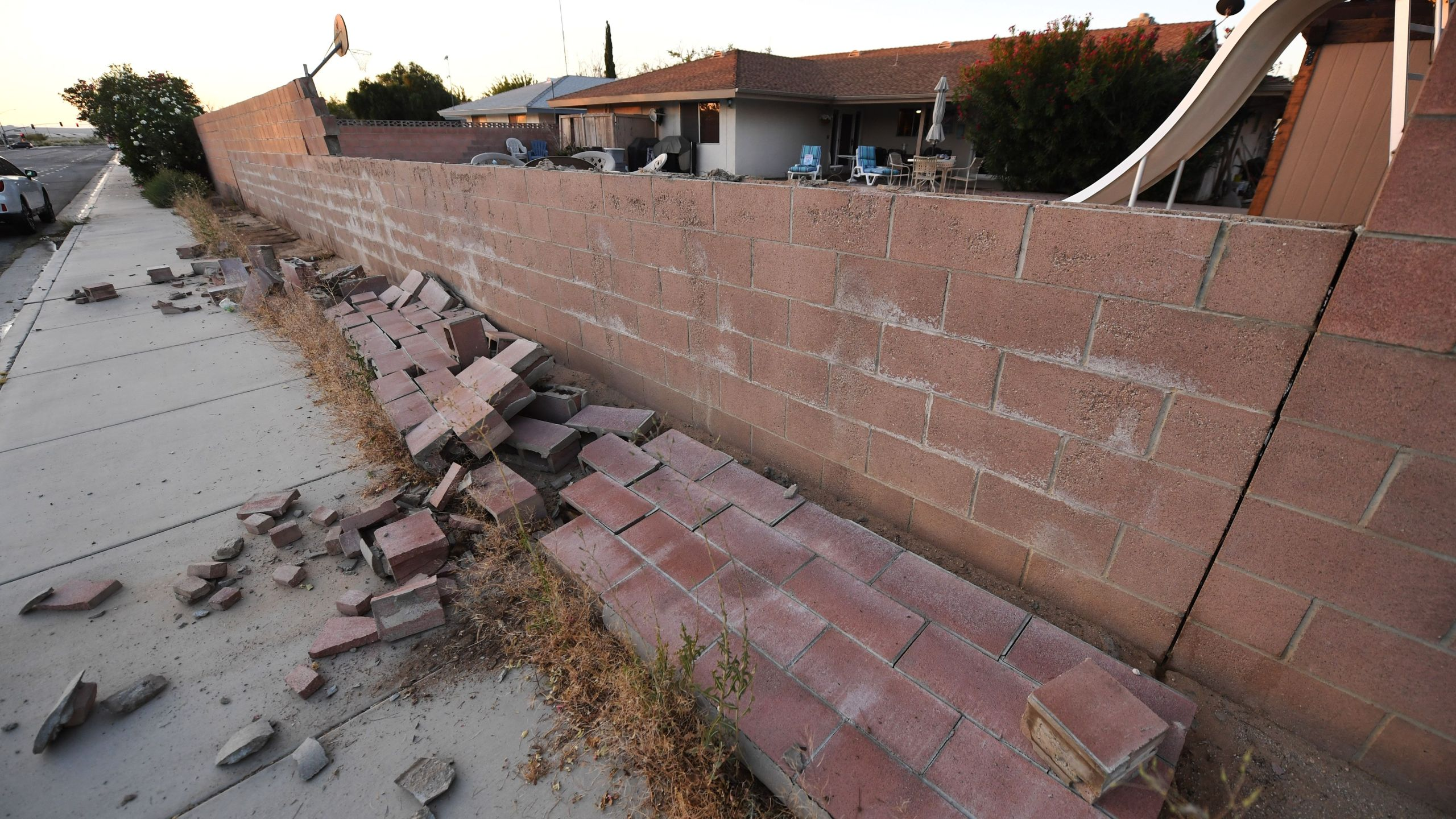 A cinderblock wall partially destroyed in Ridgecrest on July 6, 2019, following a magnitude 7.1 earthquake the previous night. (Credit: ROBYN BECK/AFP/Getty Images)
