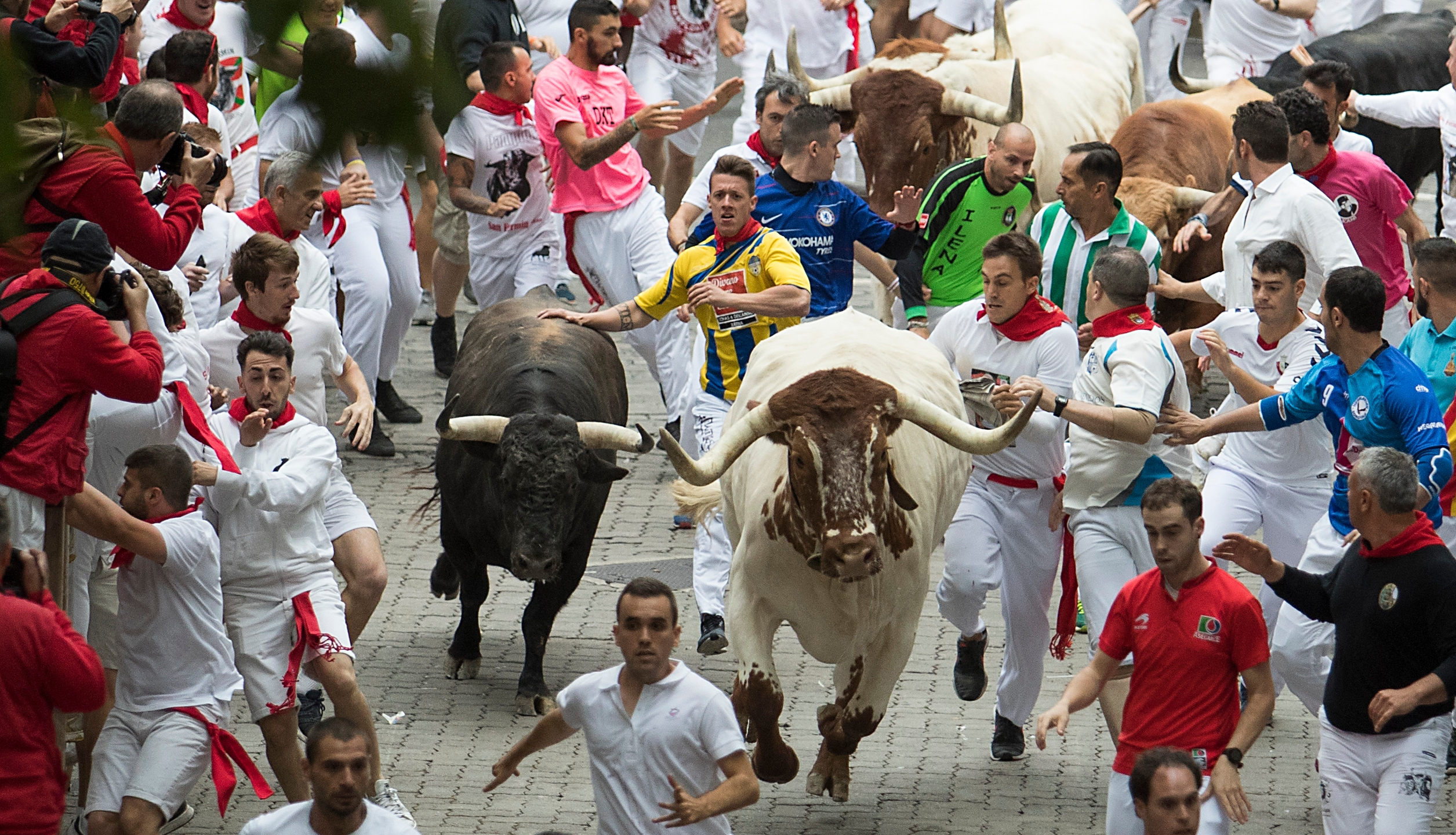 Participants run with fighting bulls during the San Fermin festival in Pamplona, northern Spain, on July 7, 2019. (Credit: Jaime Reina/AFP/Getty Images)