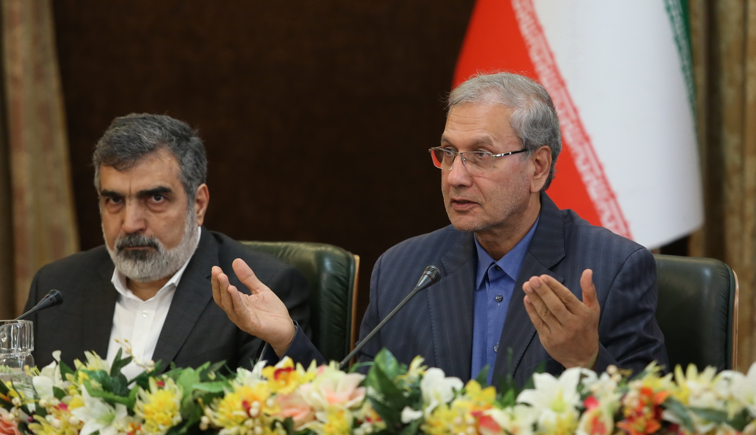 A handout picture provided by the Iranian presidency on July 7, 2019 shows (left to right) Iran's Atomic Energy Organization spokesman Behrouz Kamalvandi and government spokesman Ali Rabiei giving a joint press conference at the presidential headquarters in Tehran. (Credit: AFP/Getty Images)
