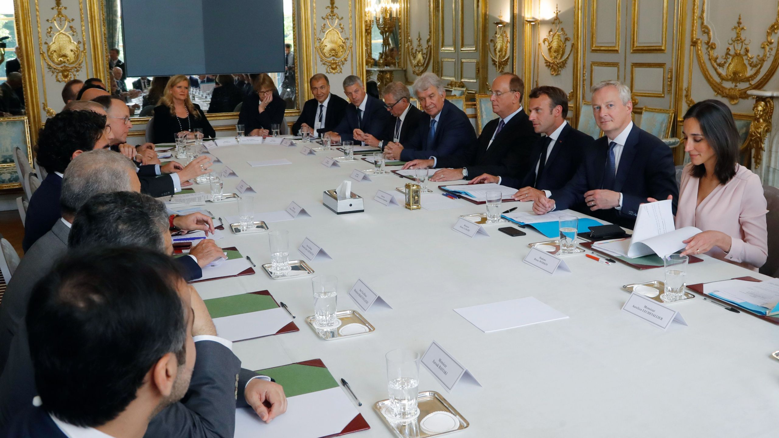 French Junior Minister for Environment Brune Poirson (right) and French Economy and Finance Minister Bruno Le Maire (second from right) attend a meeting between the French President Emmanuel Macron and representatives of investment funds and sovereign wealth funds to fight climate change at the Elysee Palace in Paris on July 10, 2019. (Credit: Michel Euler / POOL / AFP / Getty Images)
