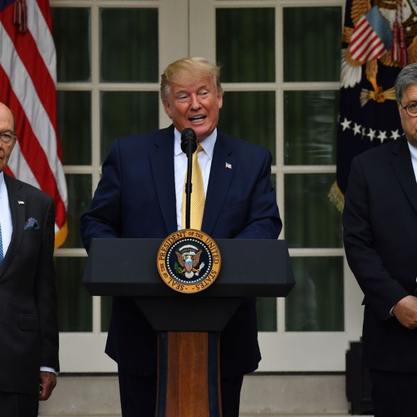 President Donald Trump, flanked by Commerce Secretary Wilbur Ross, left, and Attorney General William Barr, delivers remarks on citizenship and the census in the White House Rose Garden on July 11, 2019. (Credit: Nicholas Kamm / AFP / Getty Images)