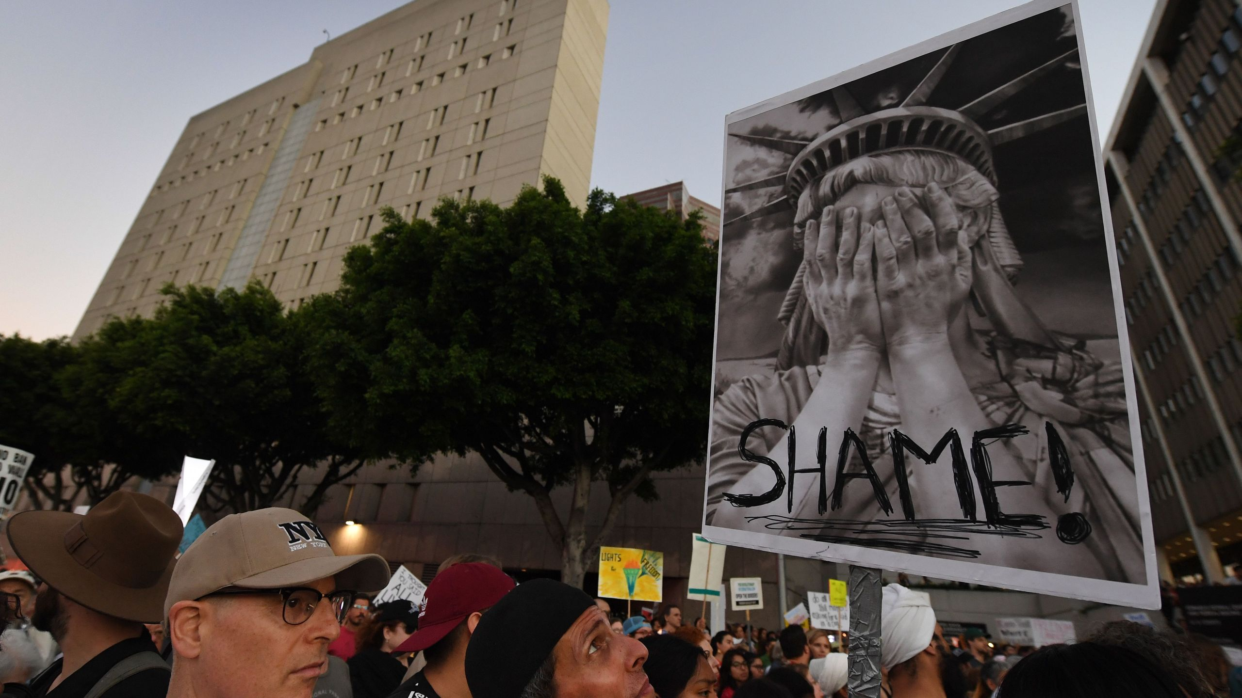 People protest against the upcoming ICE raids and detentions of refugee asylum seekers at a vigil outside the main ICE detention center in downtown Los Angeles on July 12, 2019. (Credit: MARK RALSTON/AFP/Getty Images)
