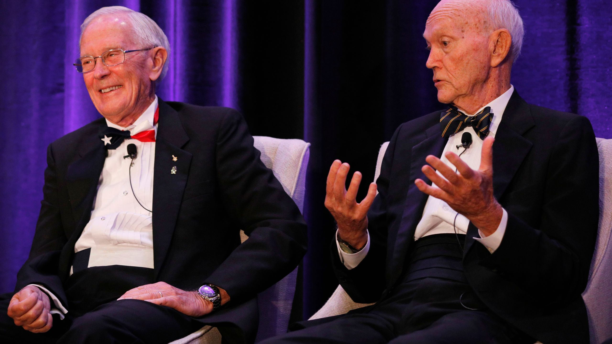 """Apollo 16 astronaut Charlie Duke, left, reacts to a remark from Apollo 11 astronaut Michael Collins during the """"Legends of Apollo"""" media event in Cocoa Beach, Florida on July 16, 2019. (Credit: Gregg Newton / AFP / Getty Images)"""