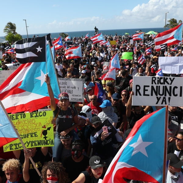 Demonstrators protest against Ricardo Rossello, the Governor of Puerto Rico July 17, 2019 in front of the Capitol Building in Old San Juan, Puerto Rico. (Credit: Joe Raedle/Getty Images)