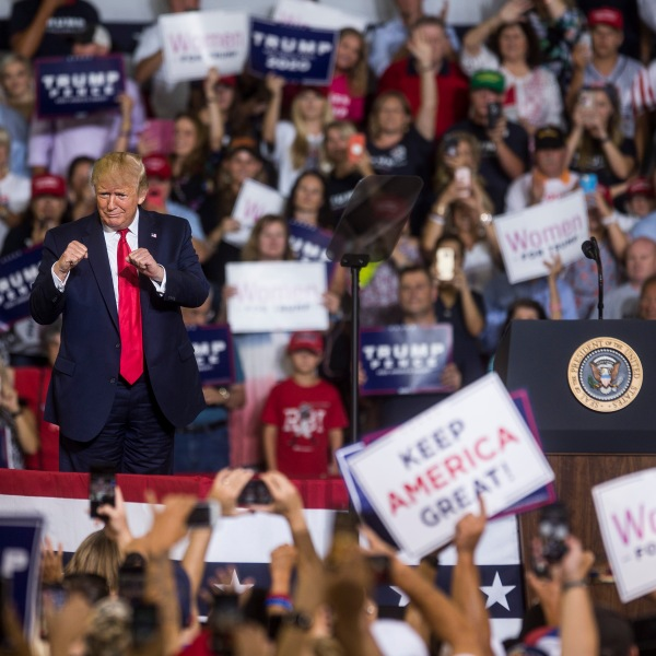 President Donald Trump takes the podium before speaking during a campaign rally in Greenville, North Carolina, on July 17, 2019. (Credit: Zach Gibson / Getty Images)