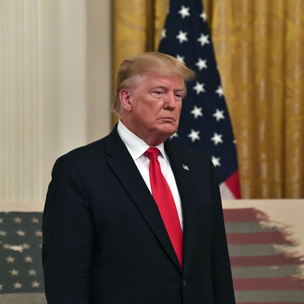 Donald Trump stands in front of a U.S. flag with Dutch Prime Minister Mark Rutte(not shown) during an East Room ceremony at the White House on July 18, 2019. (Credit: Nicholas Kamm/AFP/Getty Images)