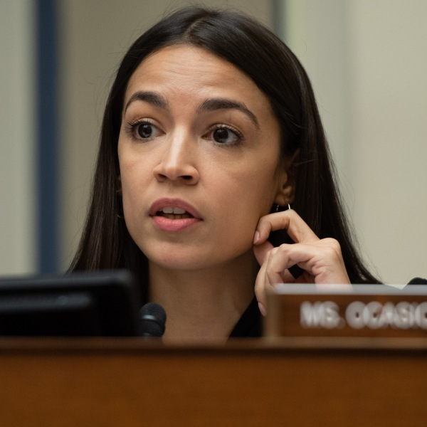 Rep. Alexandria Ocasio-Cortez, Democrat of New York, questions U.S. Acting Secretary of Homeland Security Kevin McAleenan during a House Oversight and Reform Committee hearing on Capitol Hill in Washington, D.C. on July 18, 2019. (Credit: SAUL LOEB / AFP)
