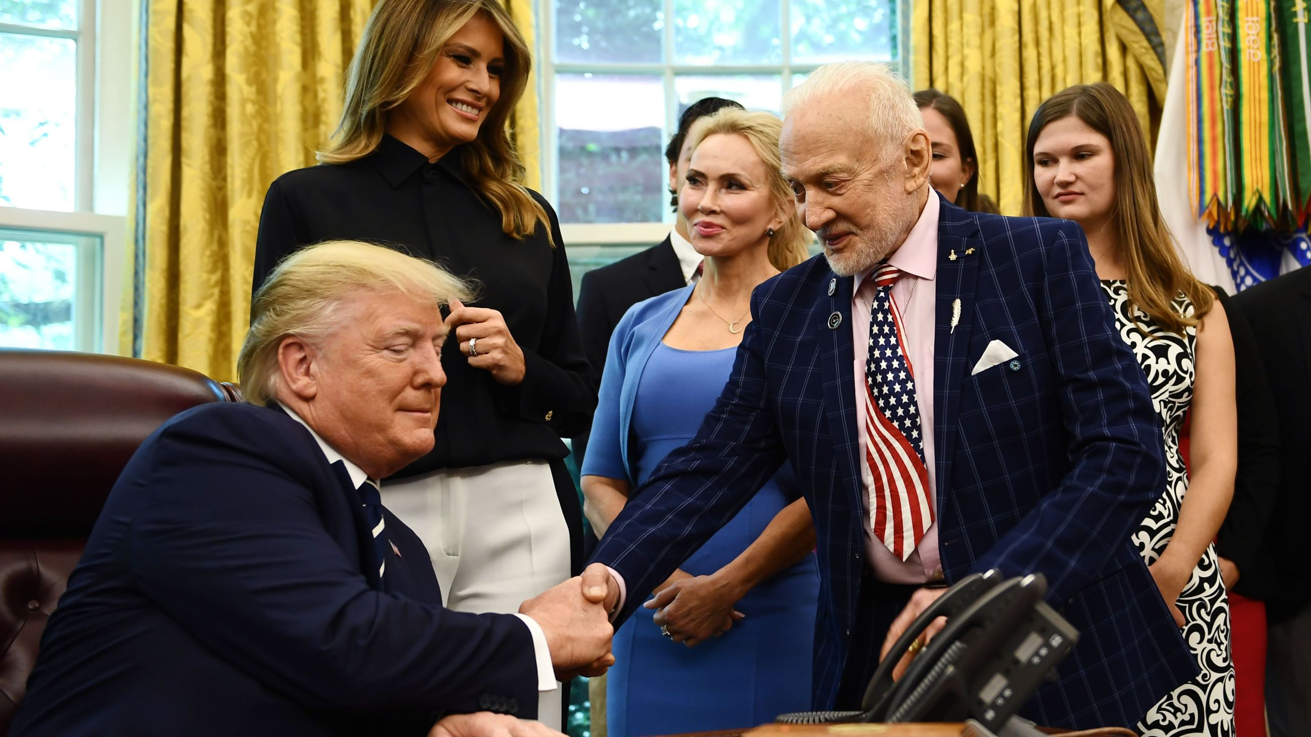U.S. President Donald Trump shakes hands with Apollo 11 crew member Buzz Aldrin on July 19, 2019, at the White House in Washington, D.C., during a ceremony commemorating the 50th anniversary of the Moon landing. (Credit: Brendan Smialowski / AFP/ Getty Images)