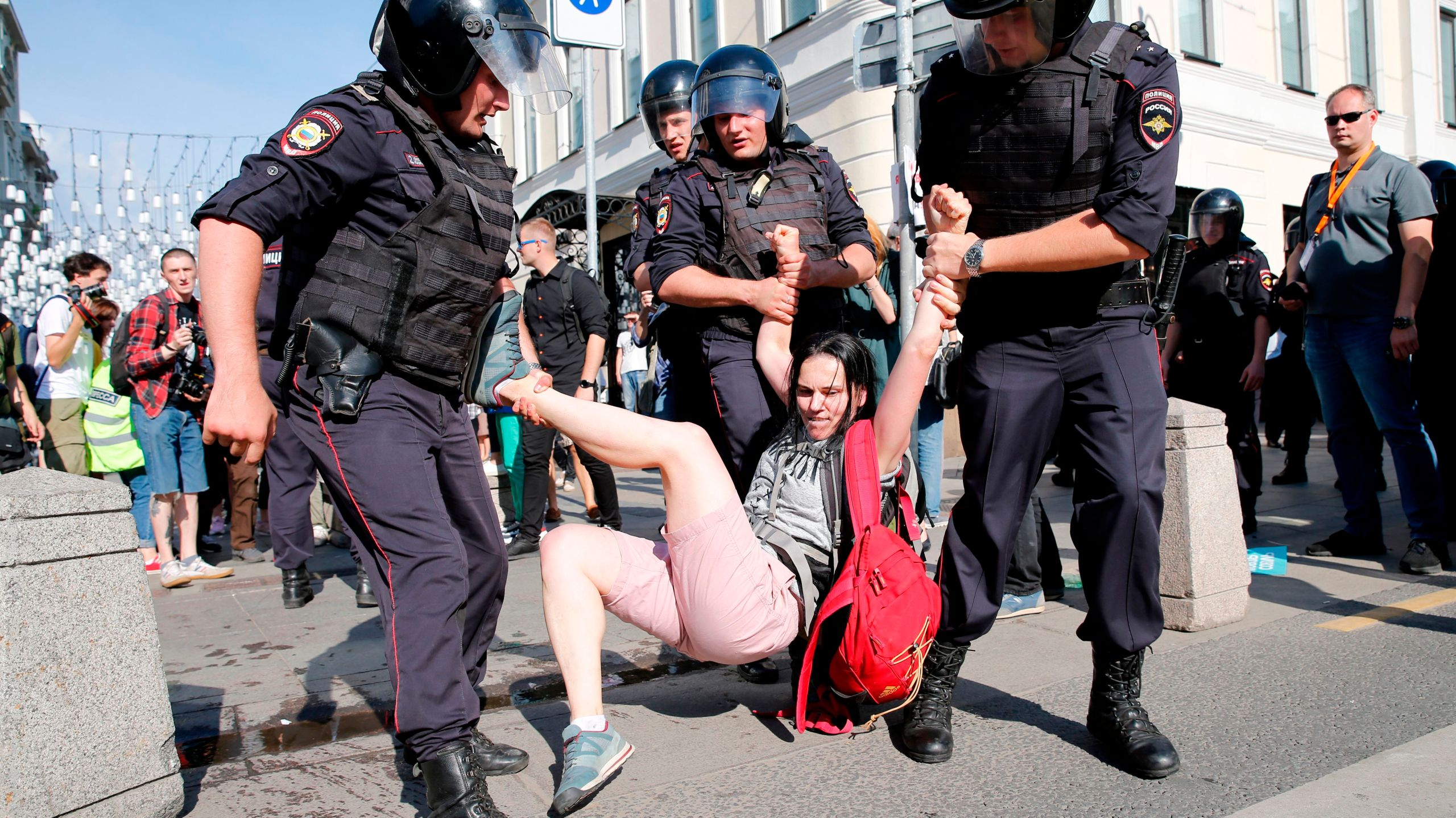 Police officers detain a protester during a rally in downtown Moscow on July 27, 2019. (Credit: Maxim Zmeyev/AFP/Getty Images)