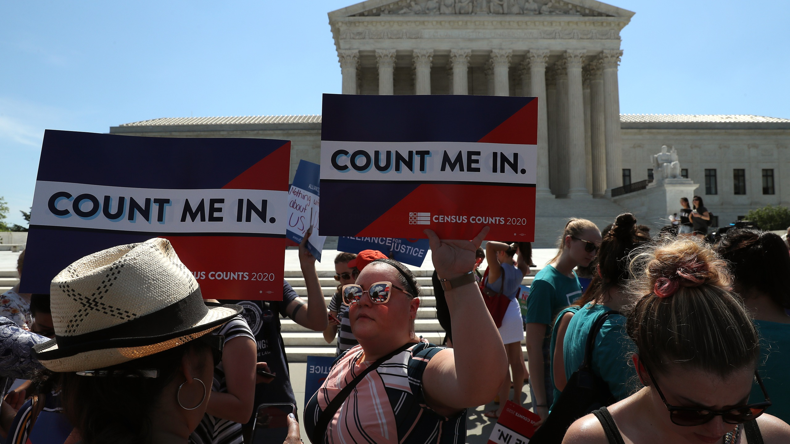 People gather in in front of the U.S. Supreme Court as decisions are handed down on June 27, 2019, in Washington, D.C. (Credit: Mark Wilson/Getty Images)
