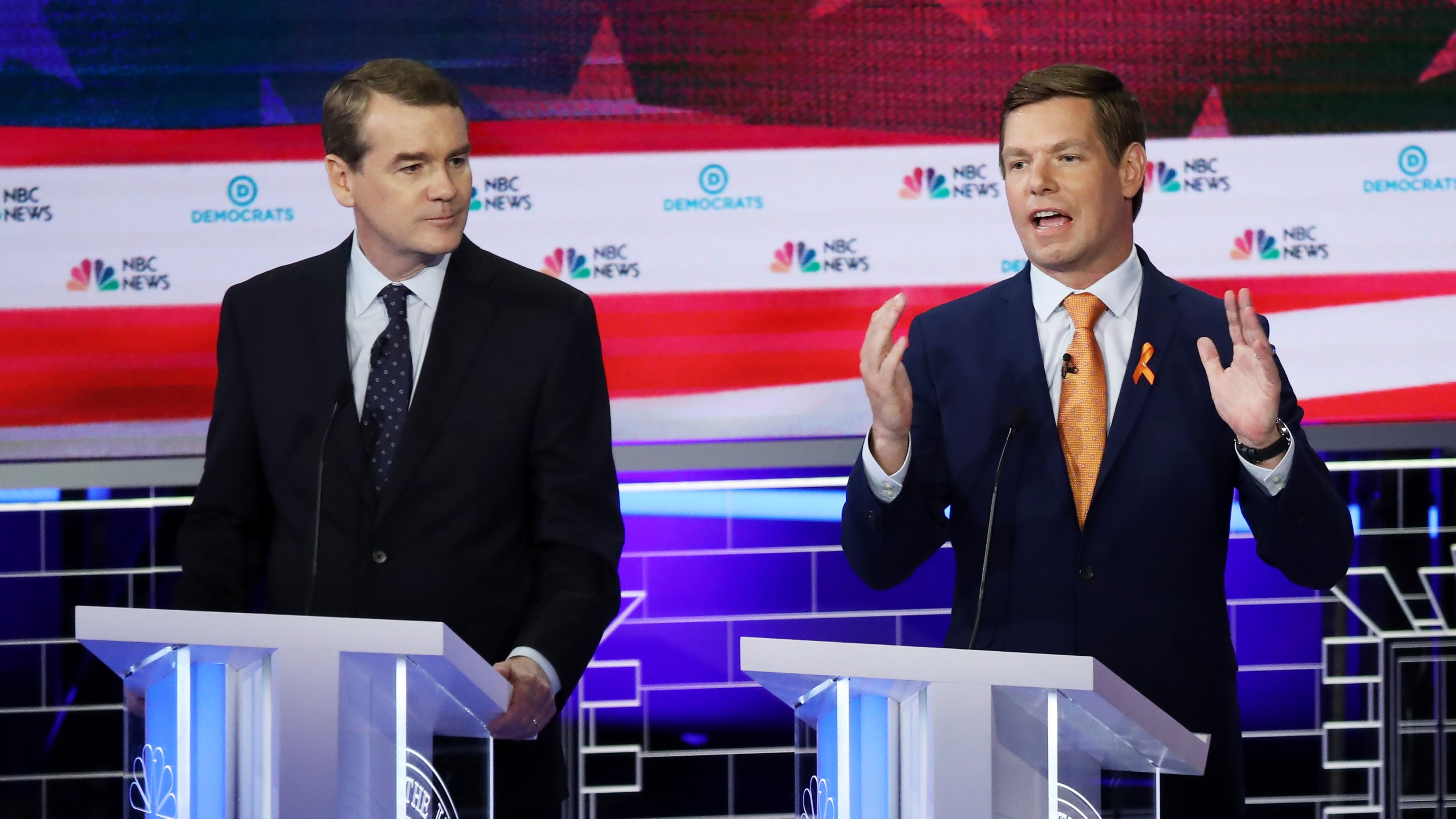Rep. Eric Swallwell, D-California, speaks as Sen. Michael Bennet, D-Colorado, looks on during the second night of the first Democratic presidential debate on June 27, 2019 in Miami. (Credit: Drew Angerer/Getty Images)